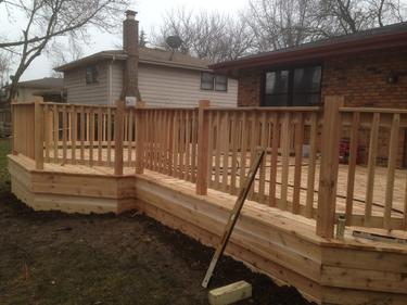 Nearly completed Darien cedar deck 2013. Deck builder A-Affordable Decks of Lombard Illinois